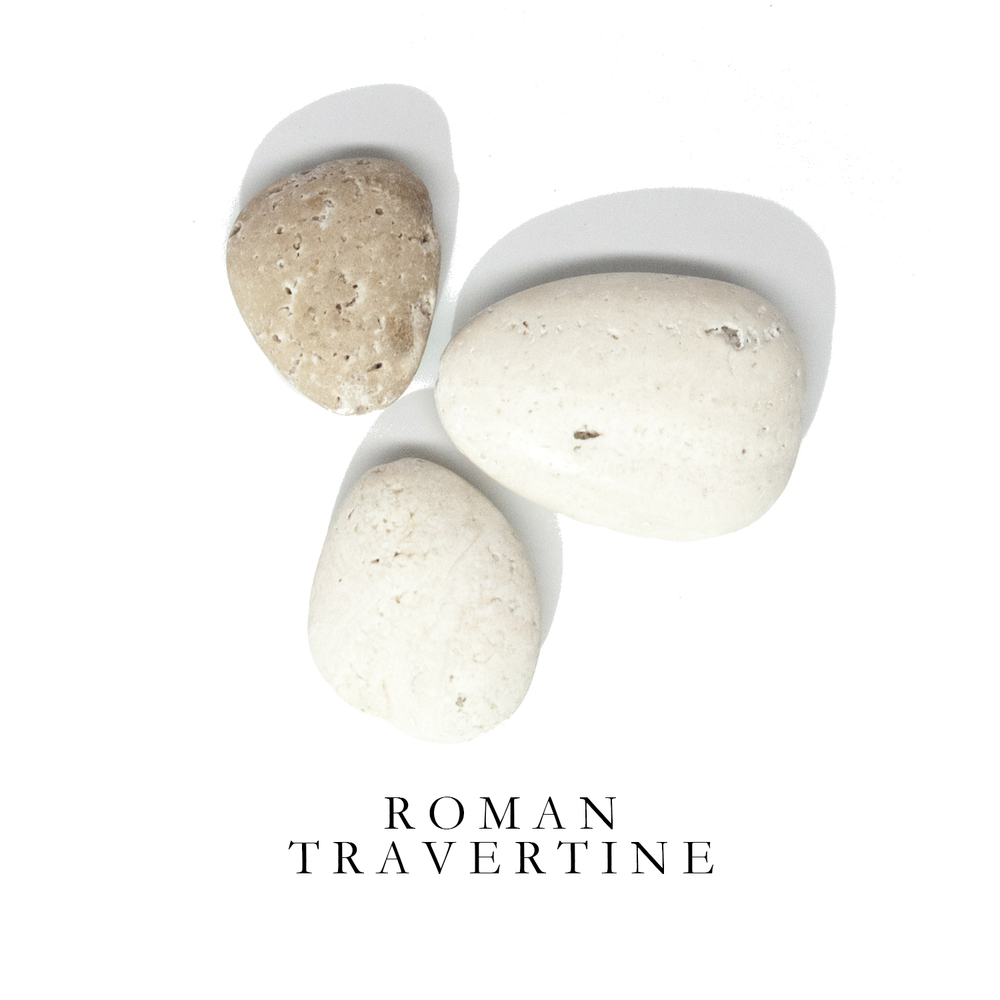 R O M A N T R A V E R T I N E - More commonly used as a building material, Roman Travertine is reminiscent of perfectly tumbled white and tan beach stones. Originally mined in Tivoli, Rome, Roman Travertine is a form of limestone deposited by mineral springs.  Notable architectural wonders throughout history have used Roman Travertine as a primary material including Paris' Sacré-Coeur, the Colosseum, the Getty House in LA, and many major works by Mies van der Rohe.  Our Roman Travertine is found in Rome of course!