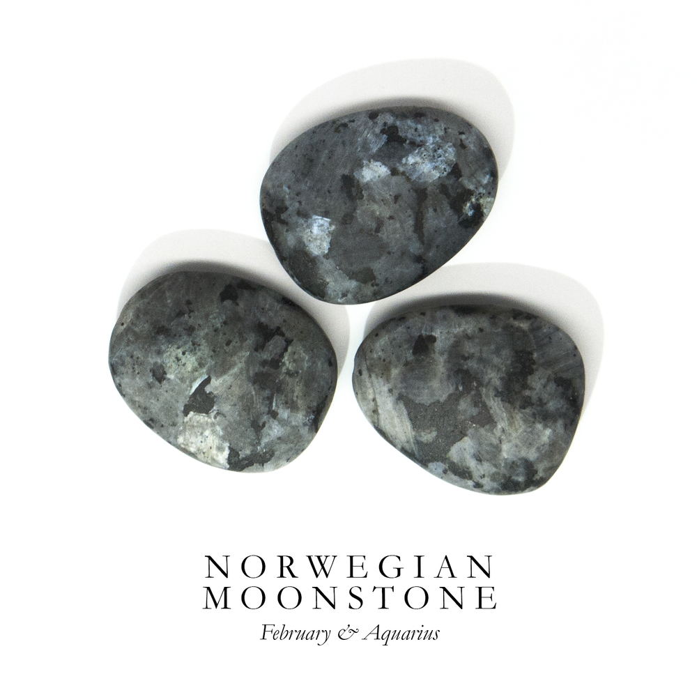 "N O R W E G I A N M O O N S T O N E - Also known as ""Larvikite"", Norwegian Moonstone is part of the Feldspar family. It resembles Labradorite in color, but has a more opaque quality with dark black and grey spots.  Norwegian Moonstone is said to maintain vitality and youthfulness. It is also a stone of inner vision and past reflection.  Norwegian Moonstone is named after the town Larvik in Norway where the largest quarry can be found."