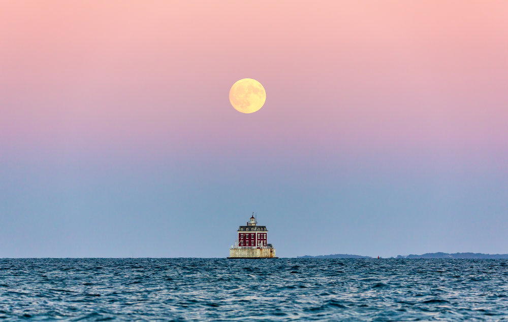 Ledge Light under a full moon.