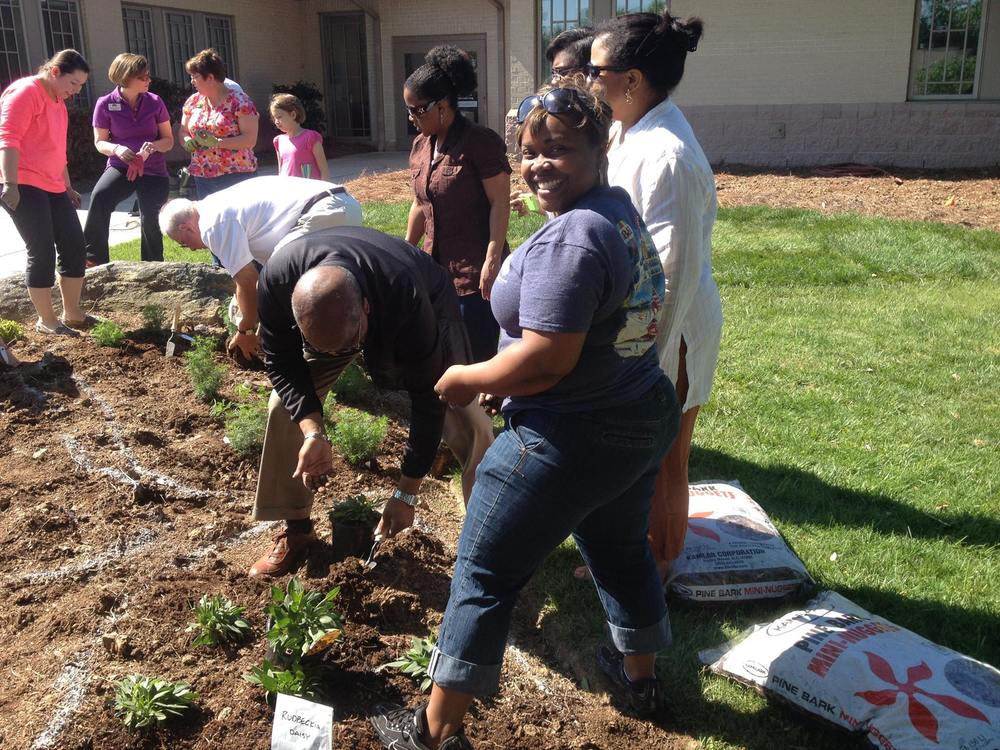 Staff & supporters plant perennials in the Memorial Garden.