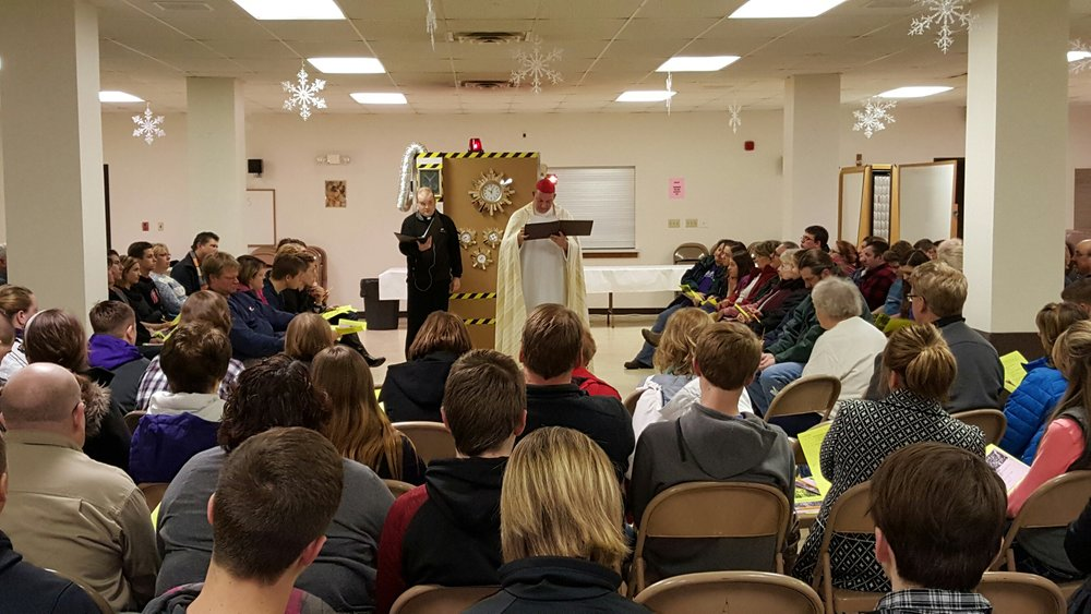"""With the """"Time machine"""", Fr. Jamie & Fr. Brian taught about the history of the mass to students and their parents."""