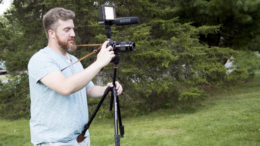 Tripod, video kit, crossbody strap.