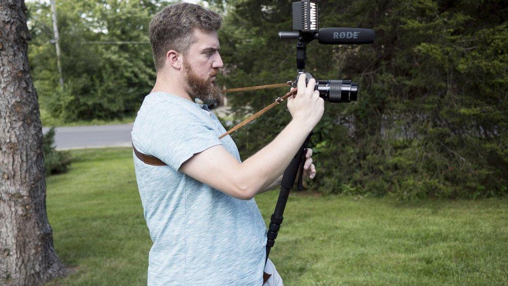 Monopod, video kit, crossbody strap.