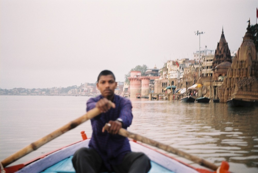 a blurred boatman