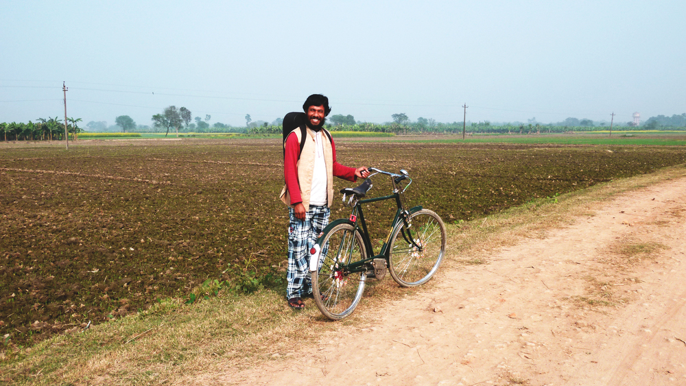 Noor Alam and his bike, a visit to a friend, December 2011 © Edith