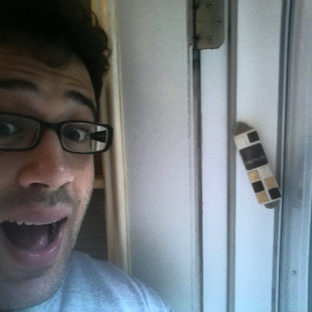 Aaron Klaus OC '10 with his brand new Oberlin Mezuzah
