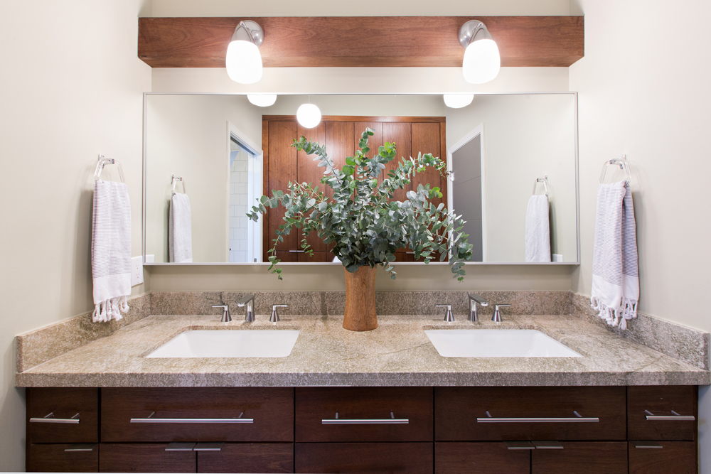 Mid-Century Modern bathroom vanity remodeled with cork flooring by Berlin based interior design firm Jamie House Design