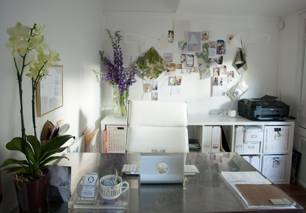 Interior Designer Jamie House of Jamie House Design's desk in design studio in the Montrose area of Houston Texas.