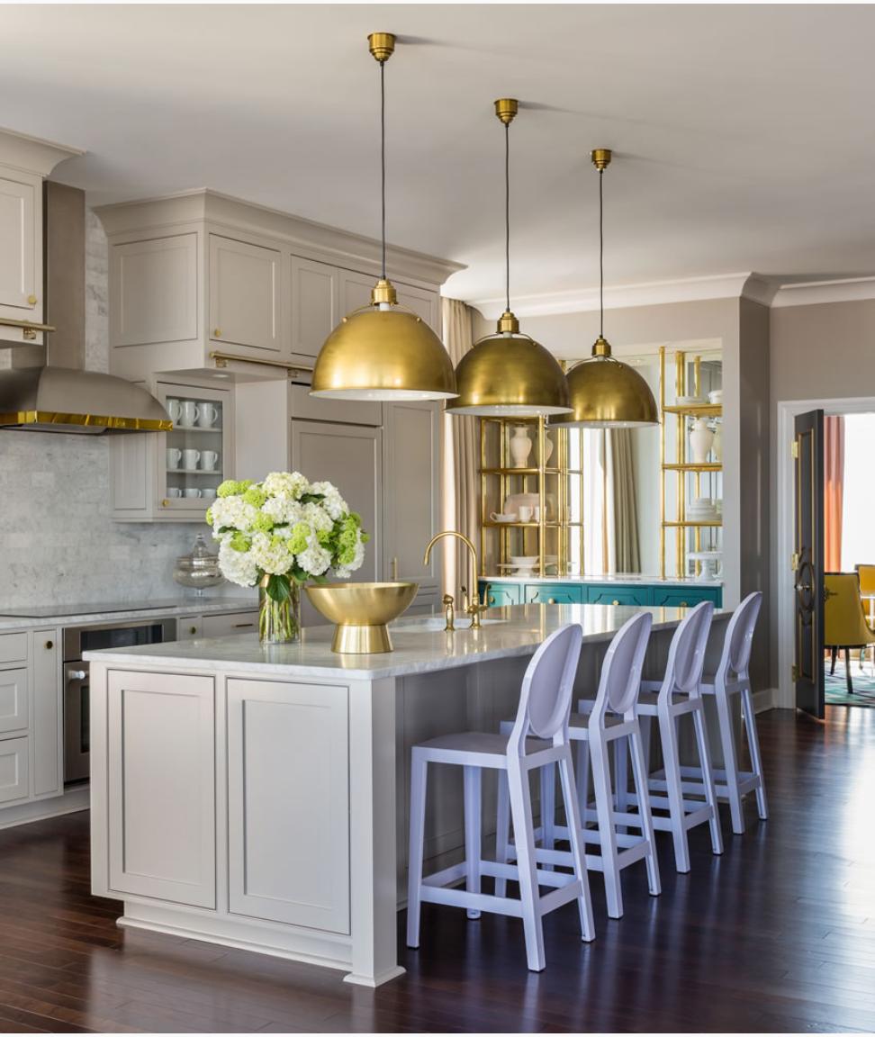 Tobi Fairley Designed Penthouse Kitchen. Lavender barstools.