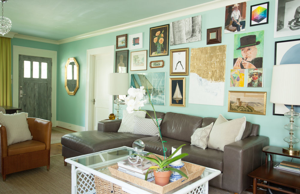 Houston Heights Historic bungalow living room featured expansive gallery wall. Designed by Jamie House of Jamie House Design.