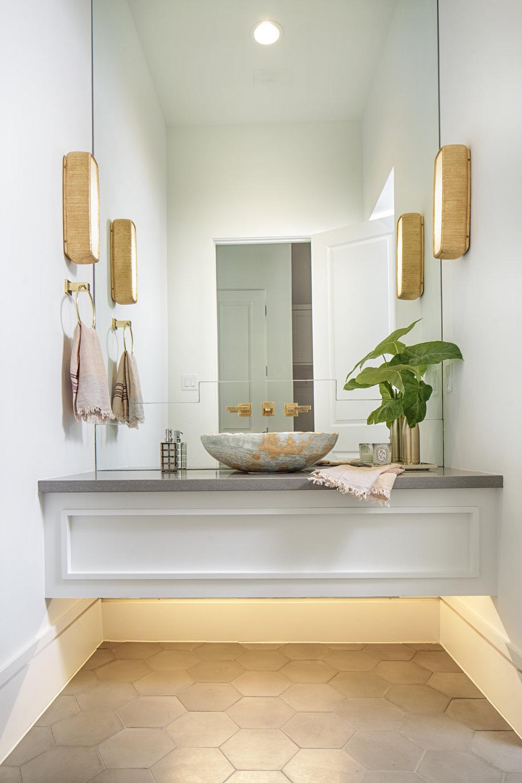 Modern contemporary powder bath. Floating vanity. Kelly Wearstler sconces. Onyx vessel sink. Powder bath designed by Jamie House of Jamie House Design.