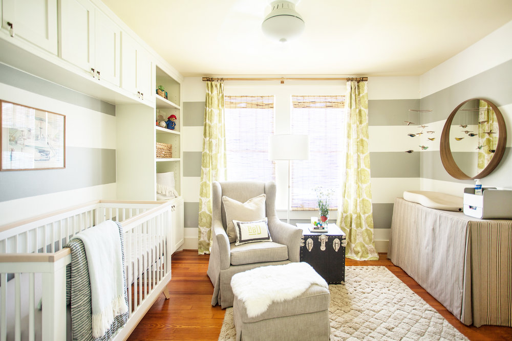 Striped wall with painted ceiling gender neutral nursery designed by Berlin based interior designer Jamie House Design