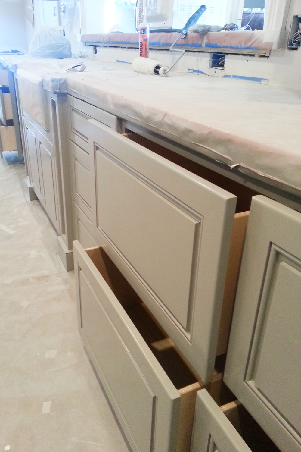 Kitchen cabinets in progress. Drawers with clear birch interiors. Jamie House Design