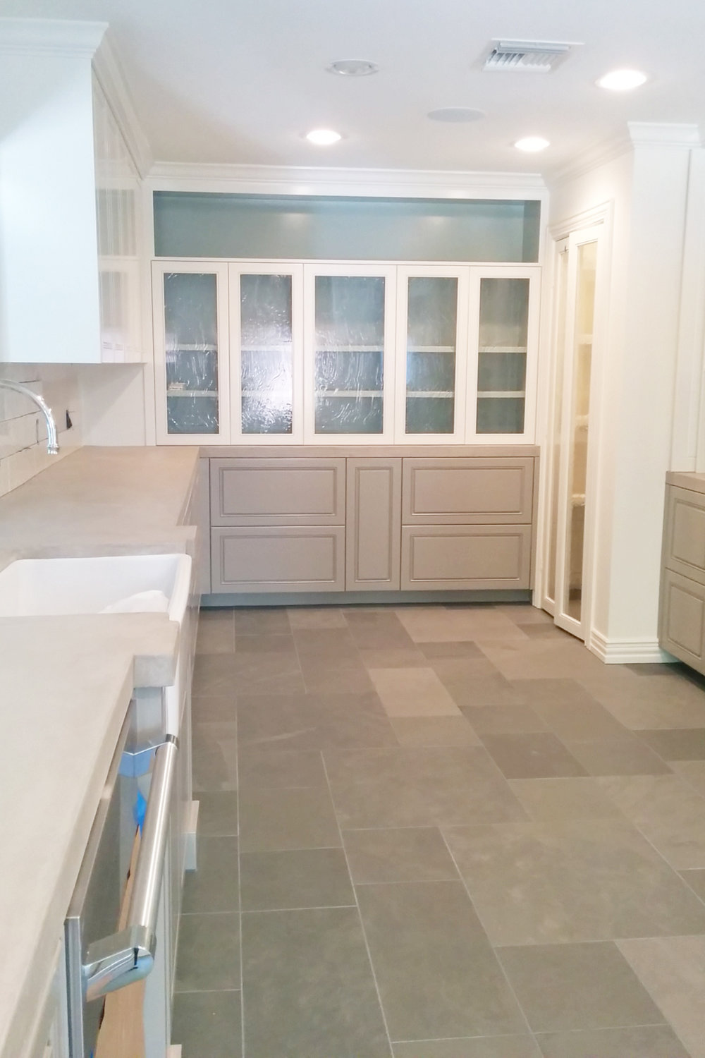 Completed glass doors display in Houston kitchen remodel. Jamie House Design