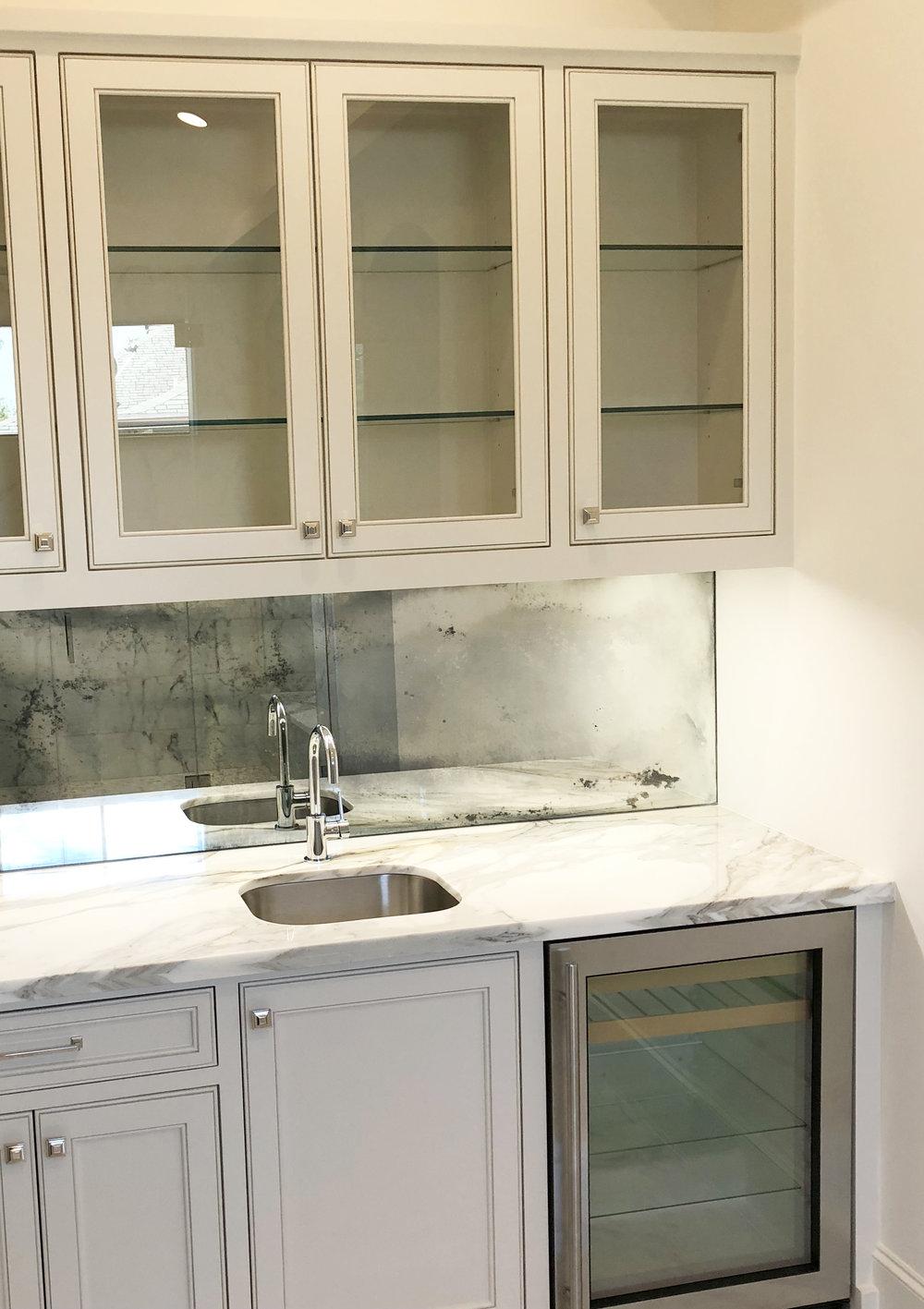 Master Suite wetbar with antique mirror backsplash designed by Berlin interior designer Jamie House. Jamie House Design. Built by CM Batts Developers.