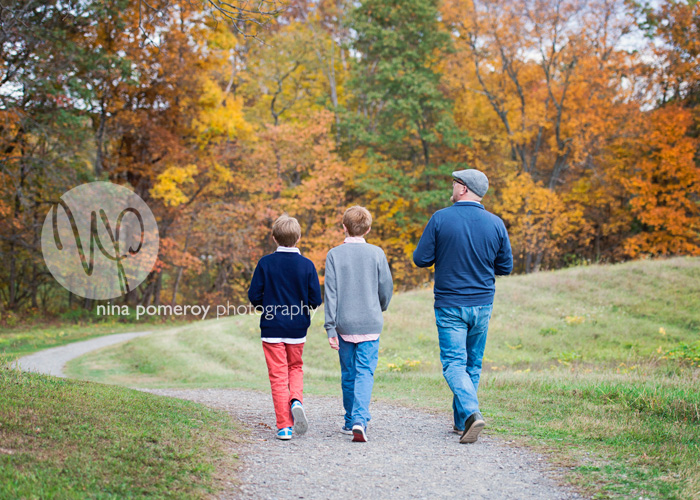 lifestyle portraits of father and son with fall foliage by ninapomeroy.com