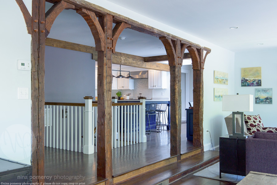 exposed beams arches farm house living room antique historic ridgefield CT interiors photographer ninapomeroy.com