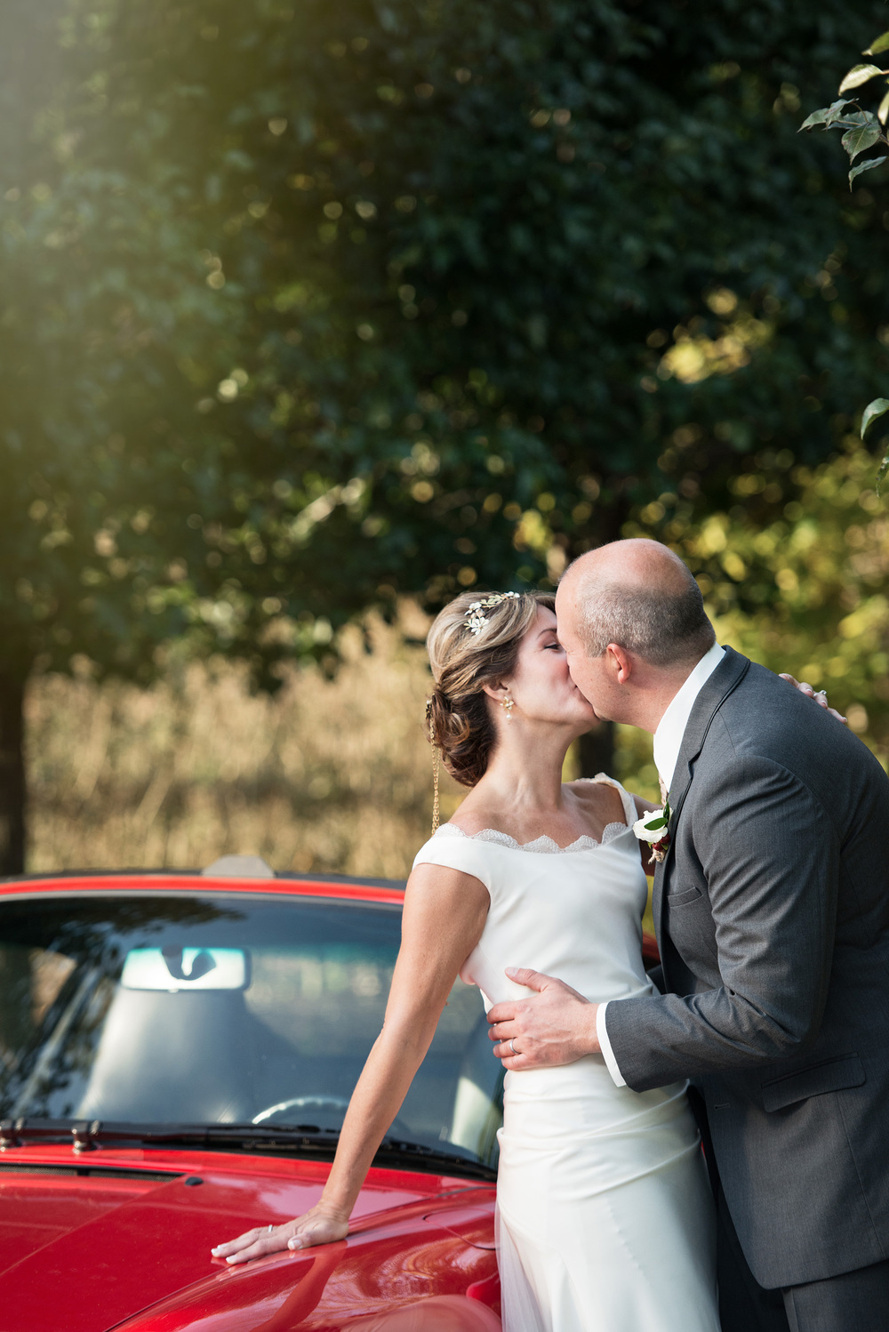 Livermore Winery vow renewal wedding anniversary with groom's vintage porsche carrera at wente