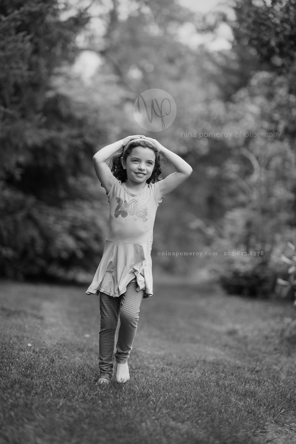 Little girls portrait taken in her favorite backyard park setting by bay area photographer nina pomeroy