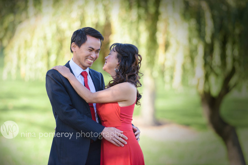 Hugs and giggles between this couple celebrating in San Ramon park session by Nina Pomeroy Photography