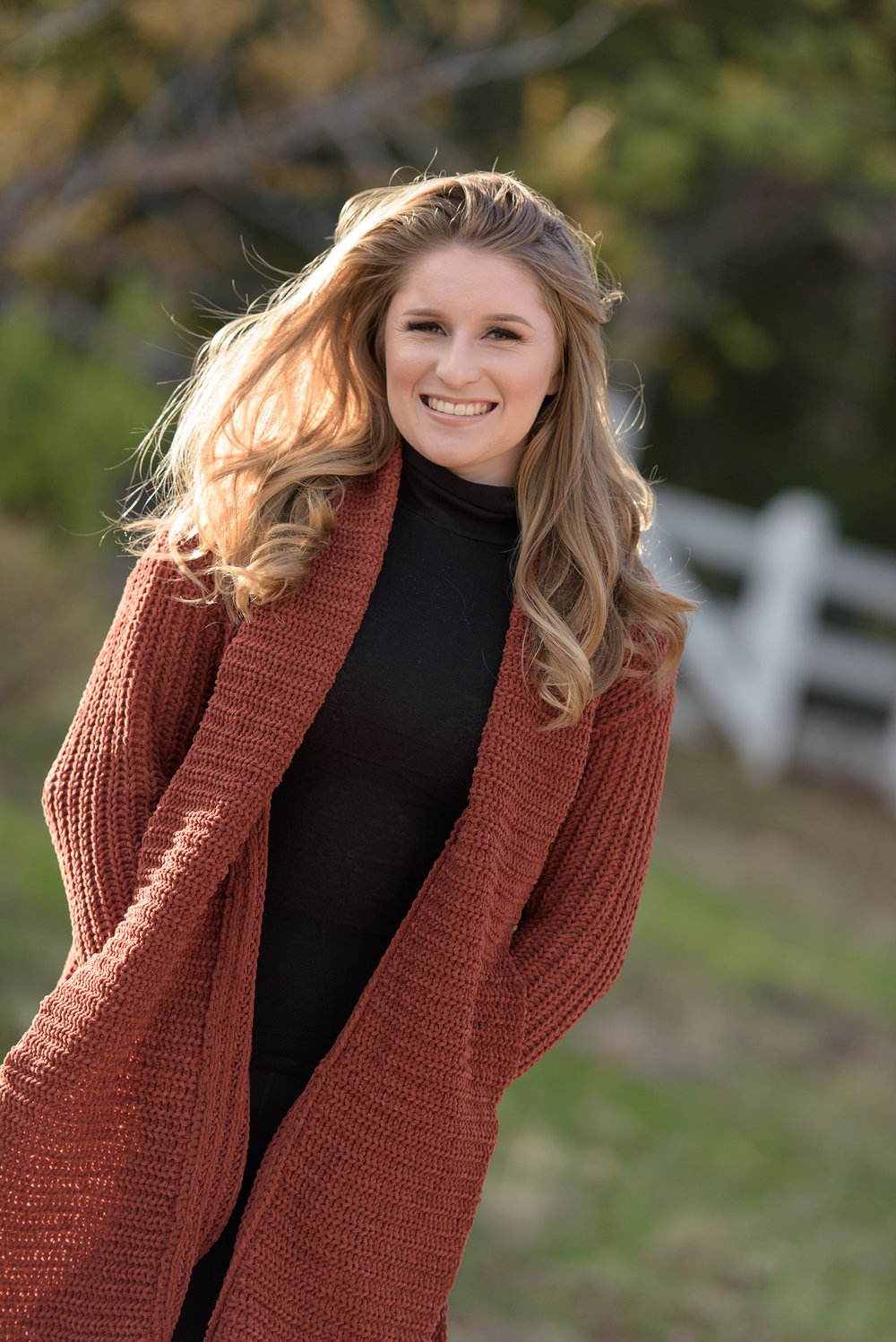 Gorgeous high school senior photos back lit by some late afternoon sun on a crisp Autumn day.