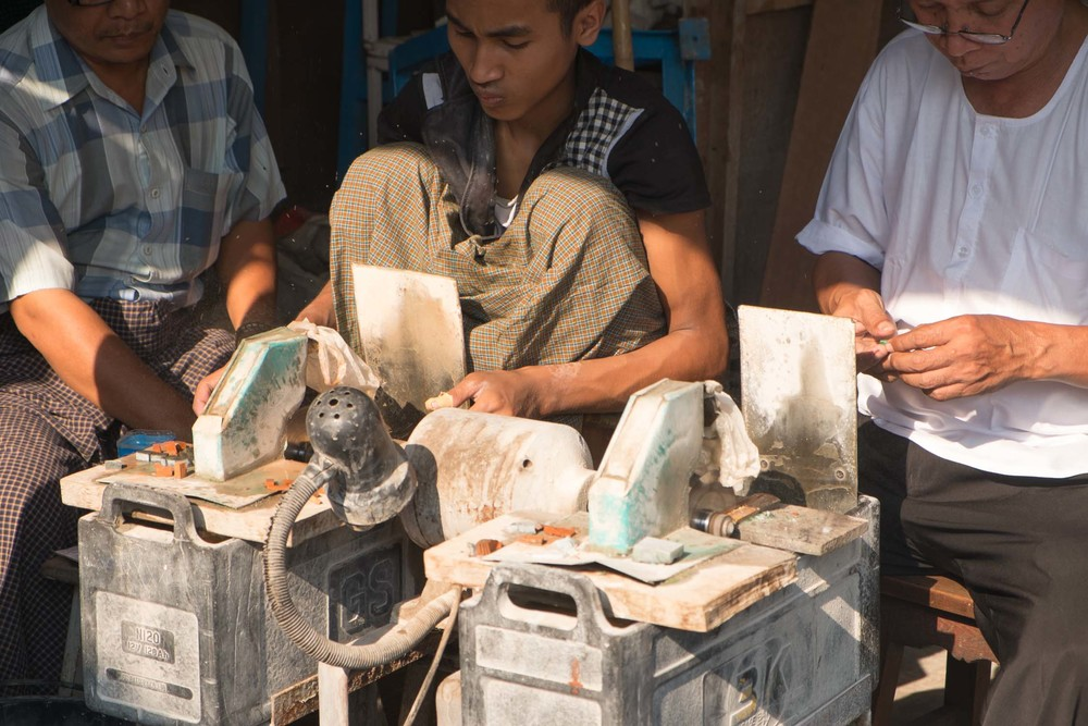sawing pieces of rough jade.