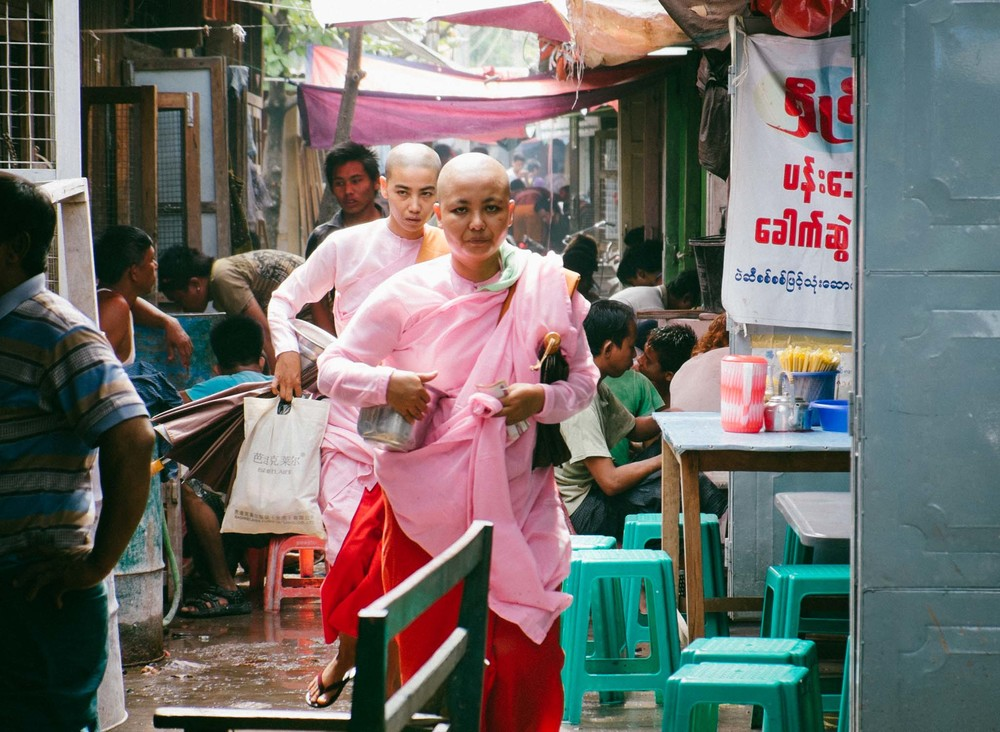 Monks often walk through the market asking for alms.