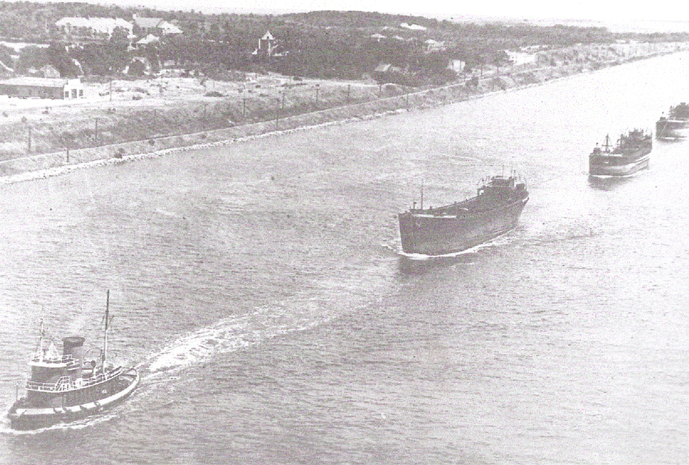 "Peterson. BELOW: The tug ""Margaret Sheridan"", of the D.T Sheridan Co., hauls a company tow eastward through Cap Cod Canal in the late 1940's. The barges are empty with tow lines shortened up for the tow through the canal. The lead barge was undoubtedly at onetime a schooner barge and probably had three masts.   Photo courtesy of Roy Eliassen"