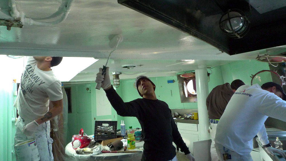 DC 9 trainees painting Mary Whalen's Galley