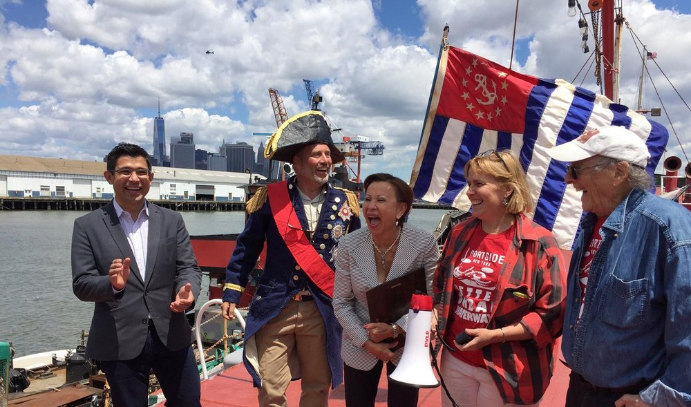 Lots of joy after Congresswoman Nydia Velazquez presents a Congressional Record to PortSide NewYork. From left to right: Councilman Carlos Menchaca, Frank Hanavan as Admiral Nelson, Congresswoman Nydia Velazquez, PortSide president Carolina Salguero, PortSide board member John Weaver