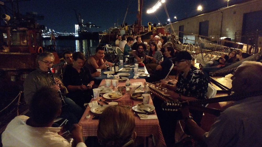Musicians from overseas and around the USA in town for the night share their music after a meal.  PortSide Second Sunday TankerTime,  August 2017.