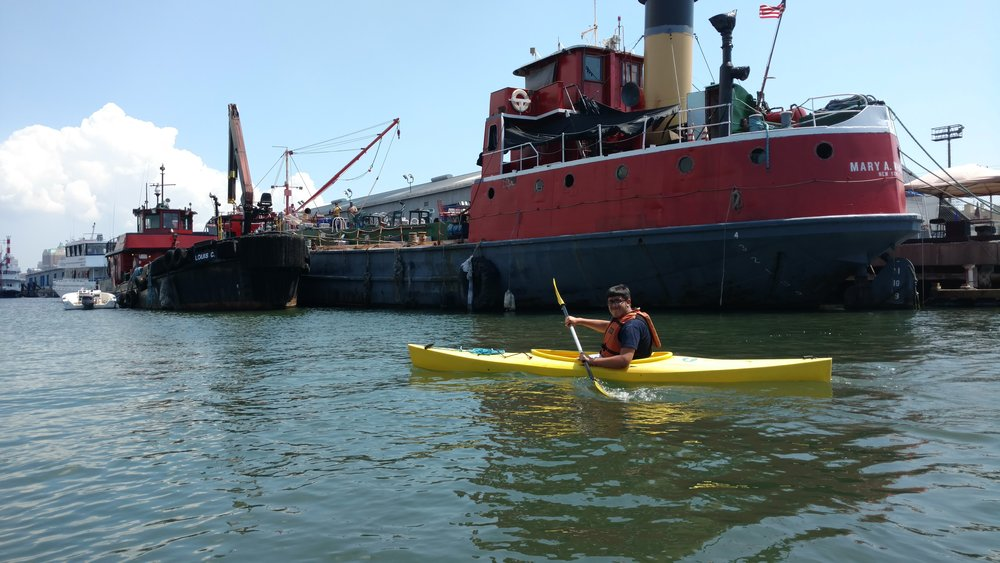 WHSAD intern learning to kayak astern of the MARY A. WHALEN