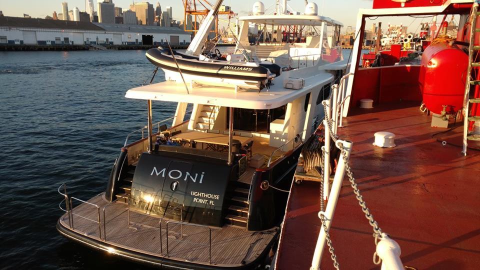 luxury yacht alongside the mary a. whalen.