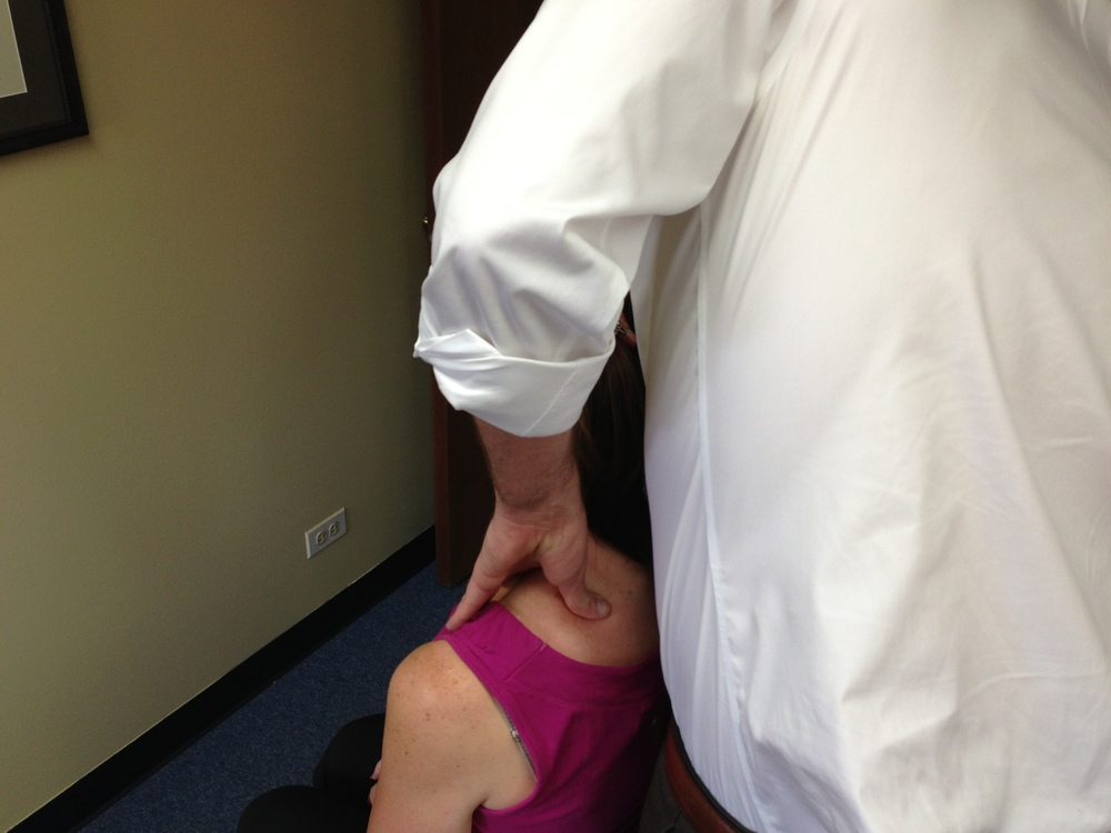 Dr. Chris works with patient experiencing shoulder impingement.