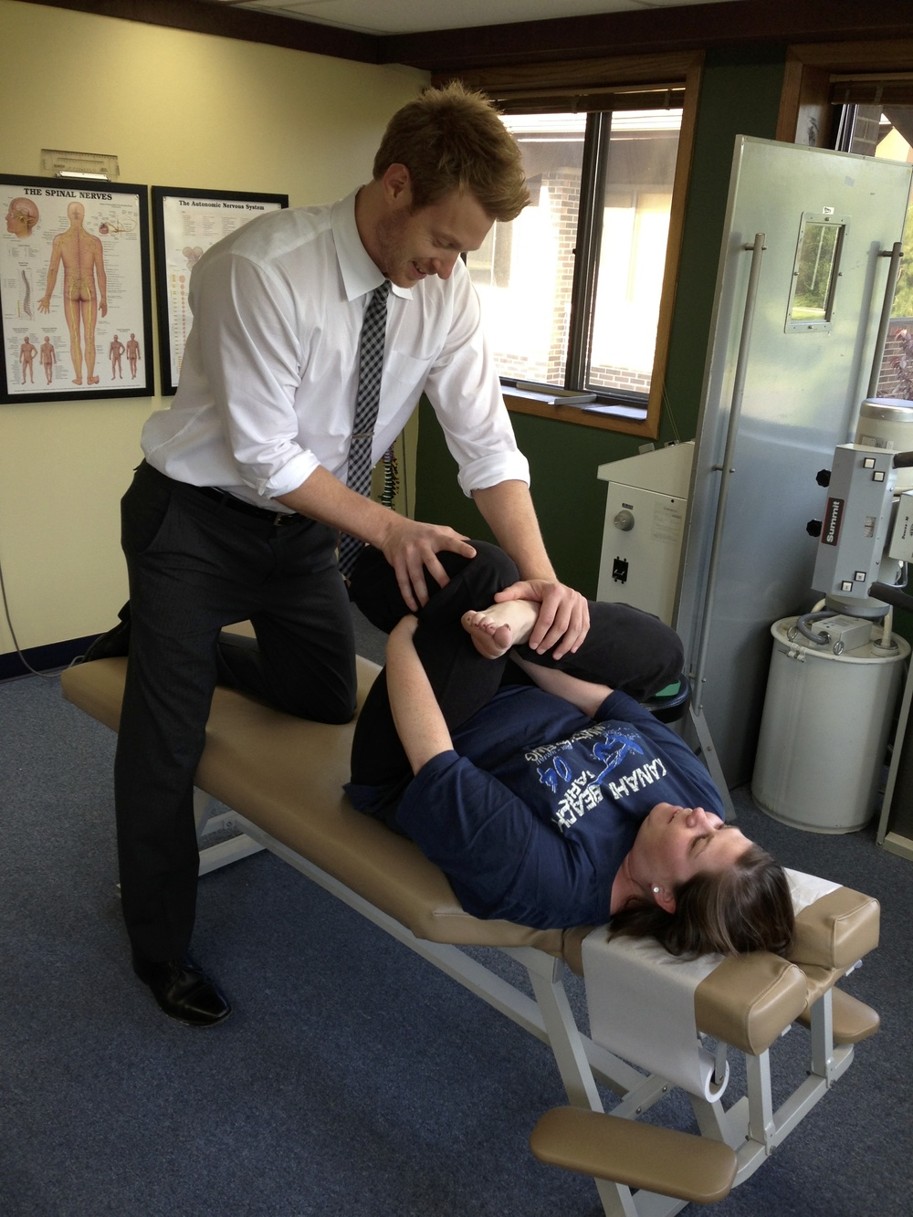 Dr. Tom stretches a patients low back
