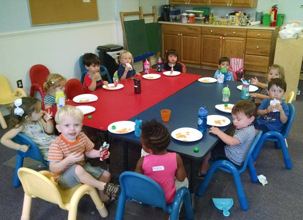 Children eat snack and lunch together at playschool.
