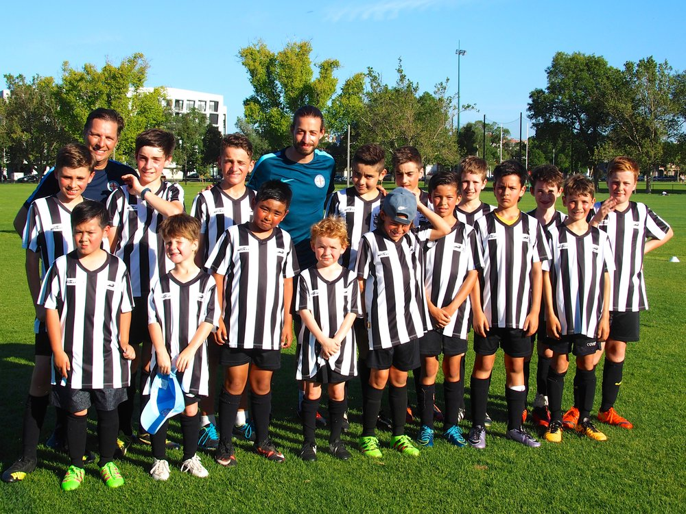 A group photo at the end of the training session with Melbourne City's junior coaches