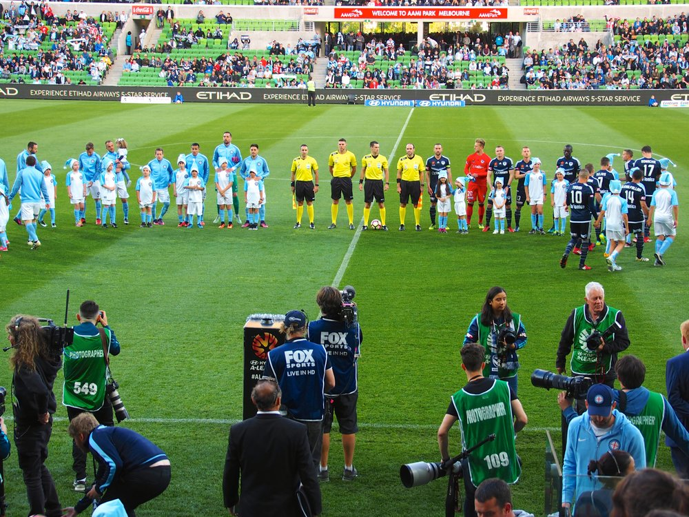 Centre of attention – Collingwood mascots line up with players at the start of the Melbourne Derby in Round 11.