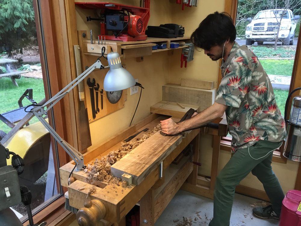 Jesse scrubs a piece of English Walnut for his cabinet