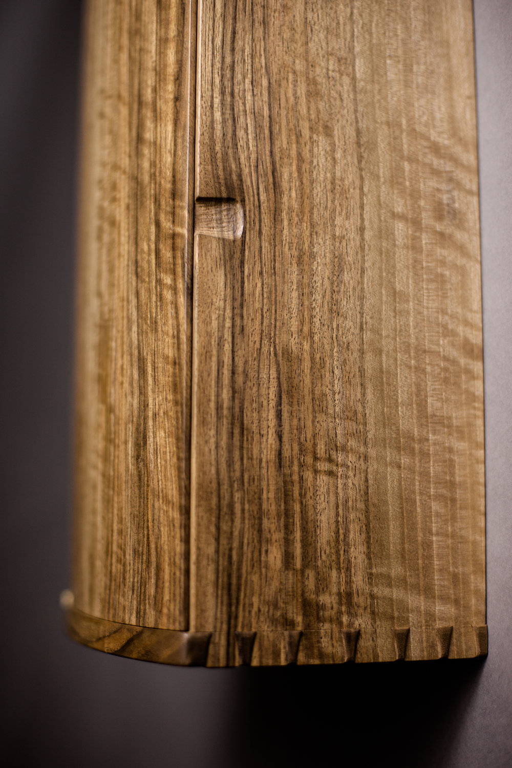 Detail proud and pillowed joinery of Upward Spiral Cabinet by Jessie Lafieur  Photography by Tim Andries