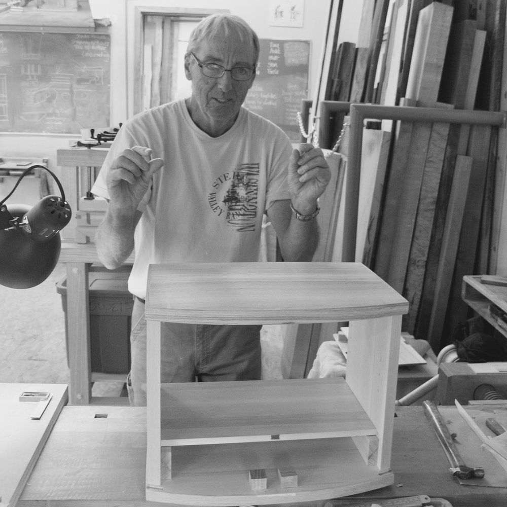 Stan and fitting the horizontal partition of his cabinet