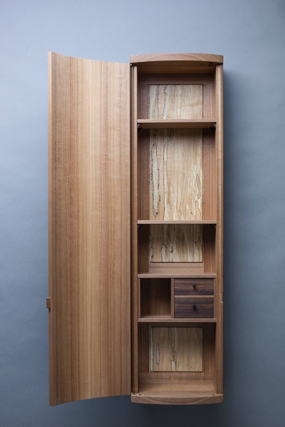 curved front cabinet in makore by Leanne featuring amazonian rosewood drawers and locally harvested spalted maple back panel photography by Tim Andres