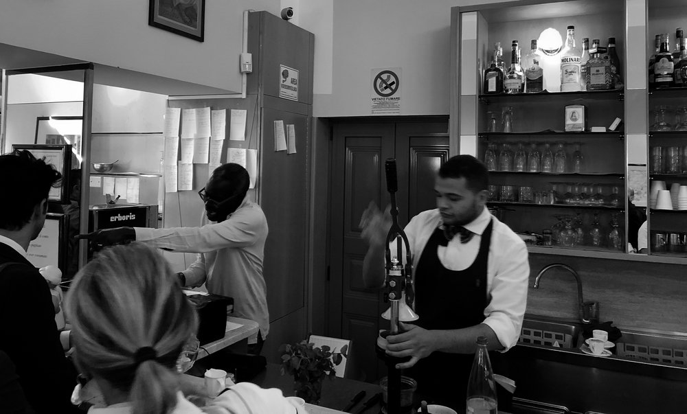 The best espresso to have in Milan! The man on the left at the register made the coffee, the owner.  #milan  #italy   #europe   #bestespresso  #photography   #monochrome  #blackandwhite   #iphone   #canon   #adobe  #vogue   #fashion   #cafe