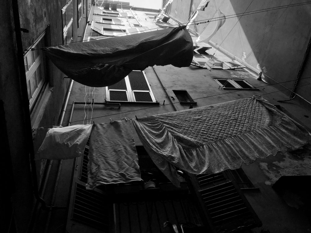 Historic Genova center is a maze in Italy! The beauty of getting lost🇮🇹  #italy   #genova   #historic   #europe  #photography   #monochrome  #blackandwhite   #iphone   #canon   #adobe  #fashion   #vogue   #maze   #streets  #architecture   #buildings