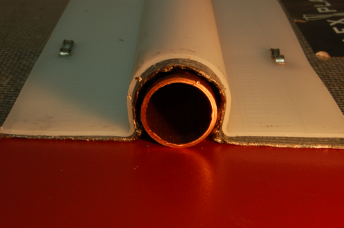 "Thin graphite cannot be formed like sheet metal and requires the polyethylene support. Photo shows significant air gap against a 5/8"" od copper tube. The tolerances are so poor that it is not possible to staple this up against the floor and firmly hold the tubing."