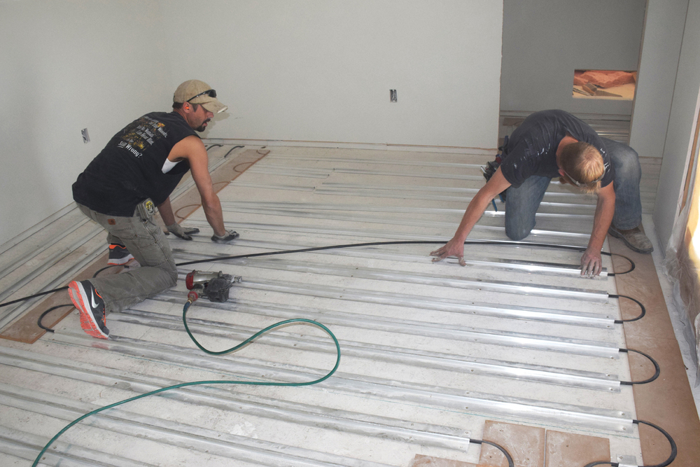 We recommend installing the fins down against the subfloor.
