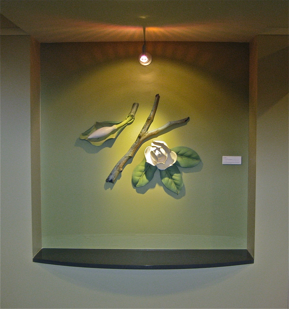 This is one of two of the niches with work inspired by the Southern Magnolia.  This one represents spring and summer.  The other was representative of fall and winter.  The niches were approximately 5 x 6 feet.  All elements were created with white earthenware and colored with oxides and colored terra sigillata.