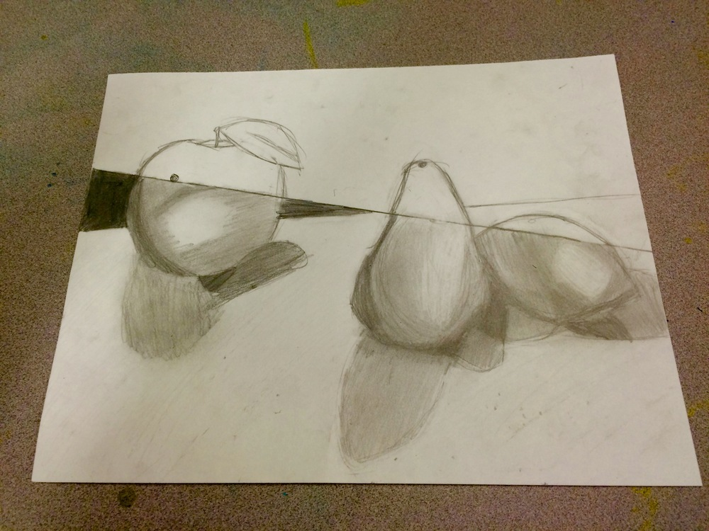 6th graders, in order to build on what they learned in 5th grade, choose 3 fruits, create a still-life, then draw it.  In addition, they divide the drawing.  Half will be black and white, the other half will be colored pencil.