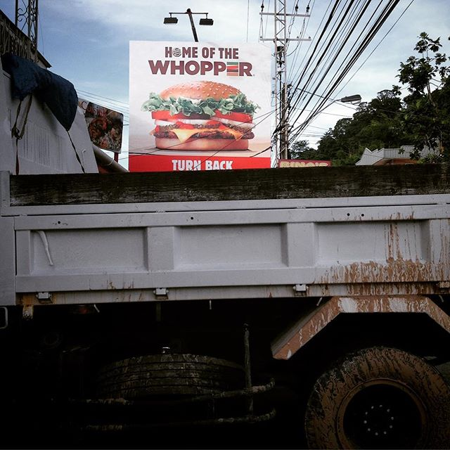 Fast food advertising on Saddle Road, Trinidad.