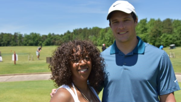 Tammie Tolbert with Mike Kueckly of NFL Carolina Panthers at TDDDF golf event.jpg